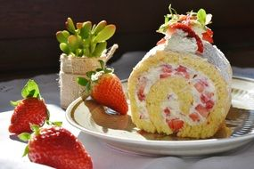Roll cake with the strawberry and cream and stawberries
