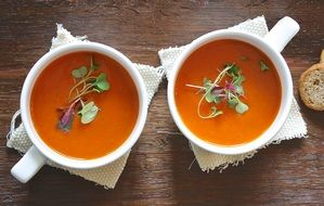 two healthy homemade soups in white cups