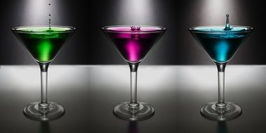 multi colored martini in glass goblets