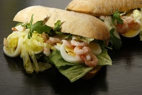 Tasty breakfast Sandwich Eggs Prawns Salad
