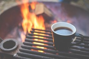 Coffee cup Heating Up on Grill