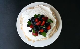 Tasty Mixed Berries cream on Cake