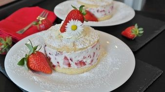 strawberry cake on a white plate