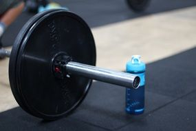 dumbbell and bottle of water