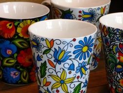 ceramic cups with colorful drawings
