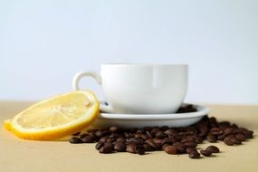 cup of coffee, grains and lemon