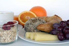 healhty Breakfast with cheese, fruits and berries