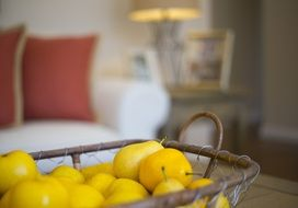 yellow ripe pears in a basket