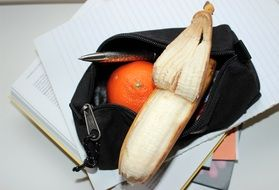 tangerine and banana in a purse