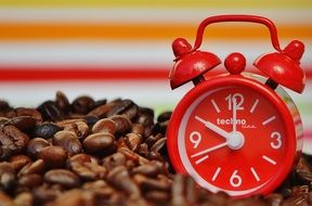 red Alarm Clock on coffee beans