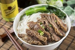 rice noodles with beef in a plate