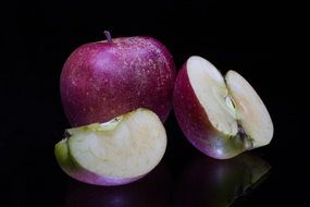purple apples on a black background