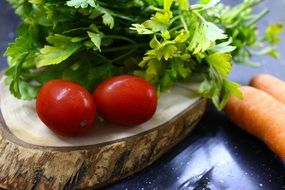 tomatoes with herbs on a cutting board