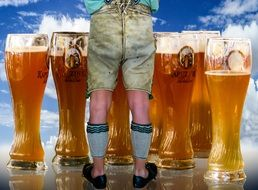 glasses of beer and men's legs in stockings and shoes