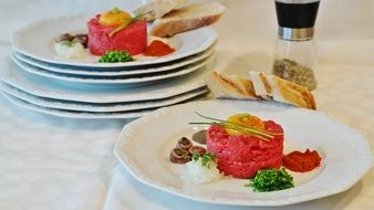 meat tartare on white plates