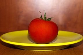 tomato on a yellow plate