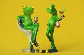 relaxing two ceramic frogs