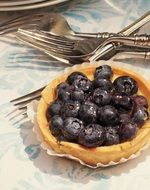 blueberry pie on the table