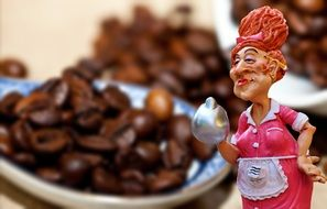 Coffee beans aback woman figure in front