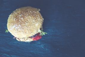 tasty hamburger on blue background