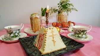 curd Easter cake with a candle on the table