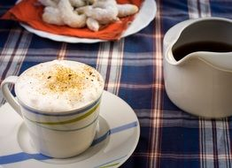 cup of cappuccino with cinnamon on the table for breakfast