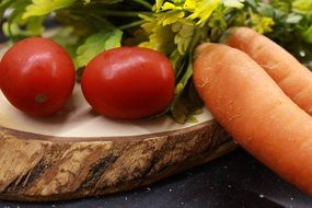 vegetables and herbs on a wooden board