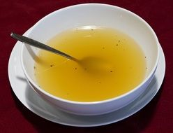 Clear chicken Broth in white Bowl