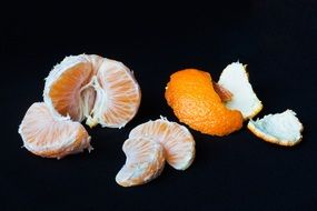 tangerine segments on the black background