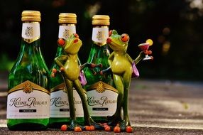 Frogs toys and Wine bottles