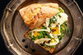 sandwich with boiled egg and herbs