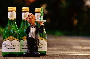 funny Waiter figurine and bottles with wine
