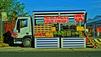 Fruit and Vegetables sale on colourful truck