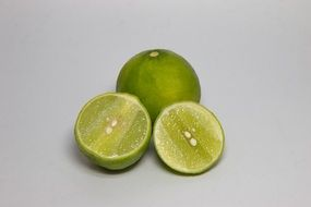 Sliced green lime on the white background