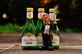Waiter with tray figurine and wine bottles