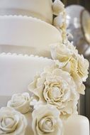 white wedding cake with roses close-up
