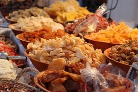 Different kind of dried fruits in the bowls