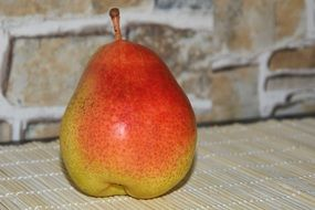 yellow-red pear on the kitchen table