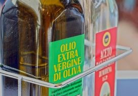 olive oil in a glass bottle and vinegar