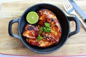 Grilled chicken and a lime