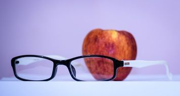 red apple and glasses