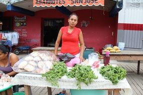 woman near counter in a market in mexico