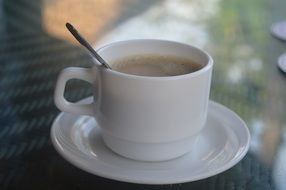hot morning coffee in a white cup