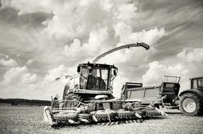 black and white photo of a harvester in a field