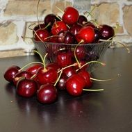 Ripe sweet delicious red cherries in the glass bowl