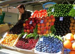 mix of fruits and vegetables on a market counter