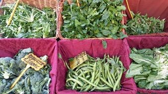 green salads and beans in the market