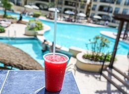 strawberry daiquiri by the pool