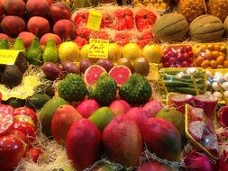 colorful fruits on a market counter