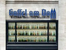 glass bottles on a beer shop window
